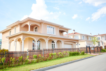 Wide angle shot beautiful two storey house in rich neighborhood, view from road, copy space Stock Photo