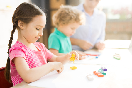 Little girl at art and craft lesson Imagens