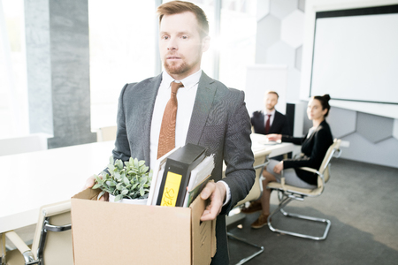 Young Businessman Leaving Job Stock Photo