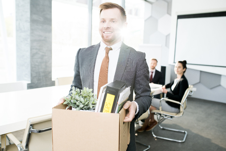 Smiling Businessman Quitting Job Stock Photo