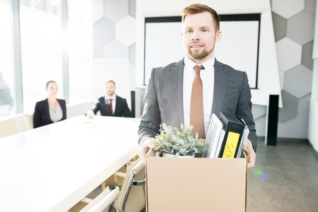 Smiling Young Businessman Quitting Job