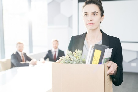 Businesswoman Leaving Job Stock Photo