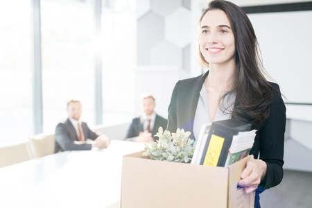 Happy Businesswoman Quitting Job Stock Photo