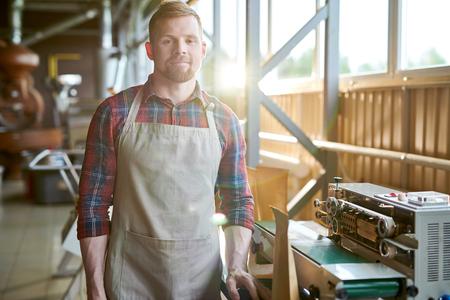 Smiling Entrepreneur Posing in Coffee Roastery