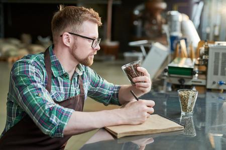 Barista Examining Coffee Roast
