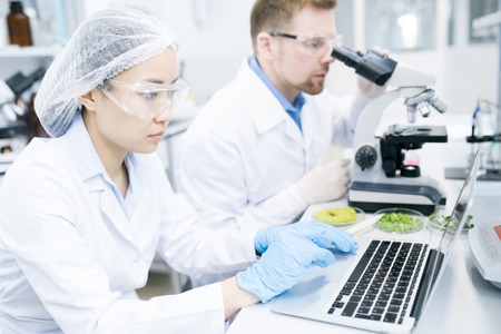 Team of Young Scientists Working in Laboratory