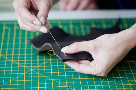 Sewing goods from leather Stockfoto - 105794041
