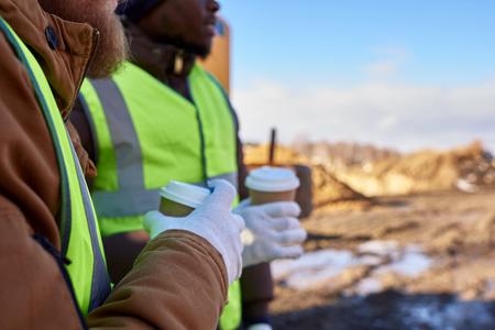 Unrecognizable Workers on Coffee Break