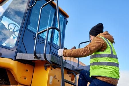 Bearded Gold Miner Climbing Truck 스톡 콘텐츠