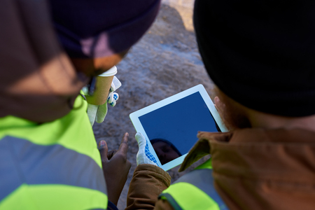 Miners Using Tablet Outdoors