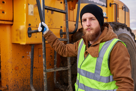 Bearded Gold Miner Posing with Truck 스톡 콘텐츠