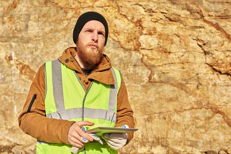 Bearded Gold Miner Inspecting Land