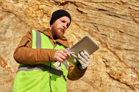 Bearded Miner Inspecting Land 스톡 콘텐츠