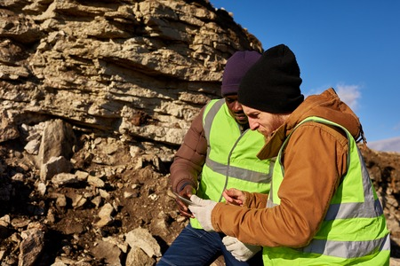 Two Gold Miners Inspecting Land