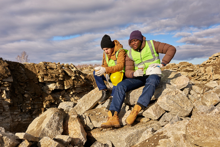 Two Workers Drinking Coffee in Alaska