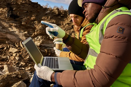 Mining  Workers Using Laptop on Excavation Site 스톡 콘텐츠