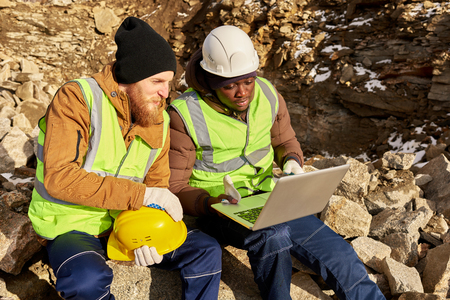 Miners Using Computer on Excavation Site 스톡 콘텐츠