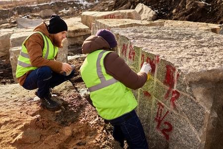Two Workers Marking Granit Blocks