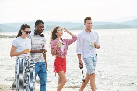 People walking along the coast 写真素材