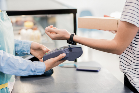 Unrecognizable Woman Paying by Smart Watch