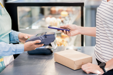 Unrecognizable Woman Paying by Smartphone