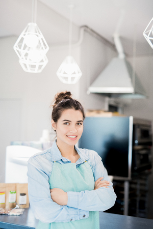Smiling Waitress in Modern Cafe Banco de Imagens