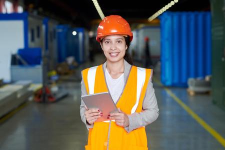 Female Factory Worker in Orange Uniform
