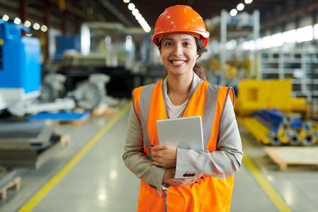 Cheerful Factory Worker Posing Standard-Bild
