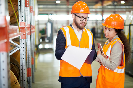 Factory Manager Talking to Employee