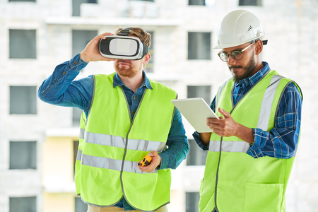 Construction Workers Using VR on Site Stok Fotoğraf