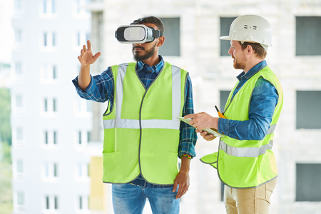 Construction Workers Using Visual Simulator on Site Banco de Imagens