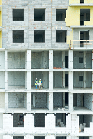 Workers in Unfinished House 写真素材
