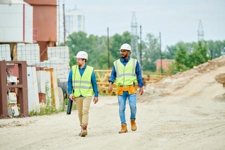 Construction Workers Crossing Site Banco de Imagens