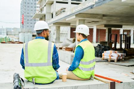Two Workers Taking Break on Site Banco de Imagens