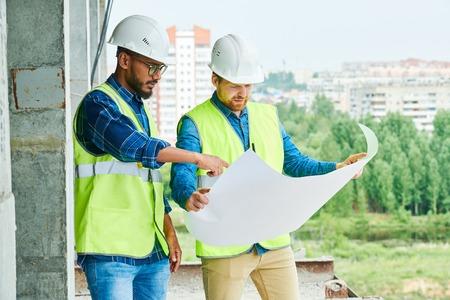 Engineers Discussing Construction Plans Banco de Imagens
