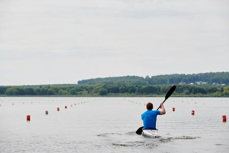 Man is kayaking