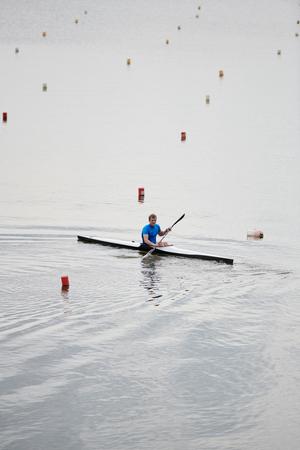 Man kayaking on the lake 写真素材 - 107762444
