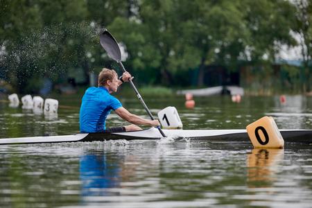 Paddler racing on the lake