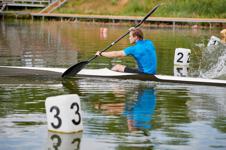 Man at rowing competition