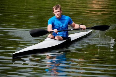 Man floating in canoe