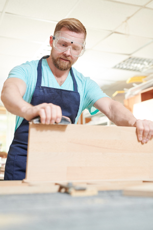 Man working with wood Stock Photo - 107762959