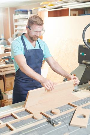 Carpenter working at factory