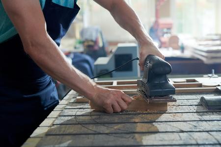 Man shaving wood Фото со стока