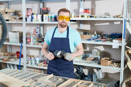 Carpenter sanding wood Stock Photo