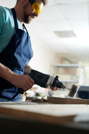Carpenter working with drill Stock Photo - 107763163