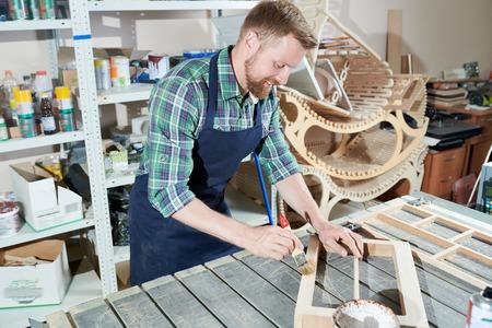 Carpenter painting wood