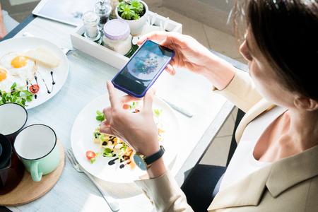 Woman Taking Photo of Food