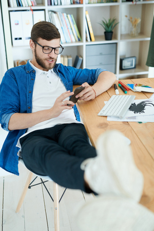 Young Man Chilling in Office Stock Photo