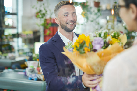 Man Buying Flower Bouquet Stock Photo