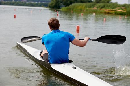 Rower floating in a canoe 写真素材